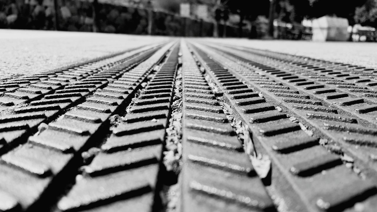 surface level, selective focus, no people, rail transportation, railroad track, transportation, day, close-up, outdoors