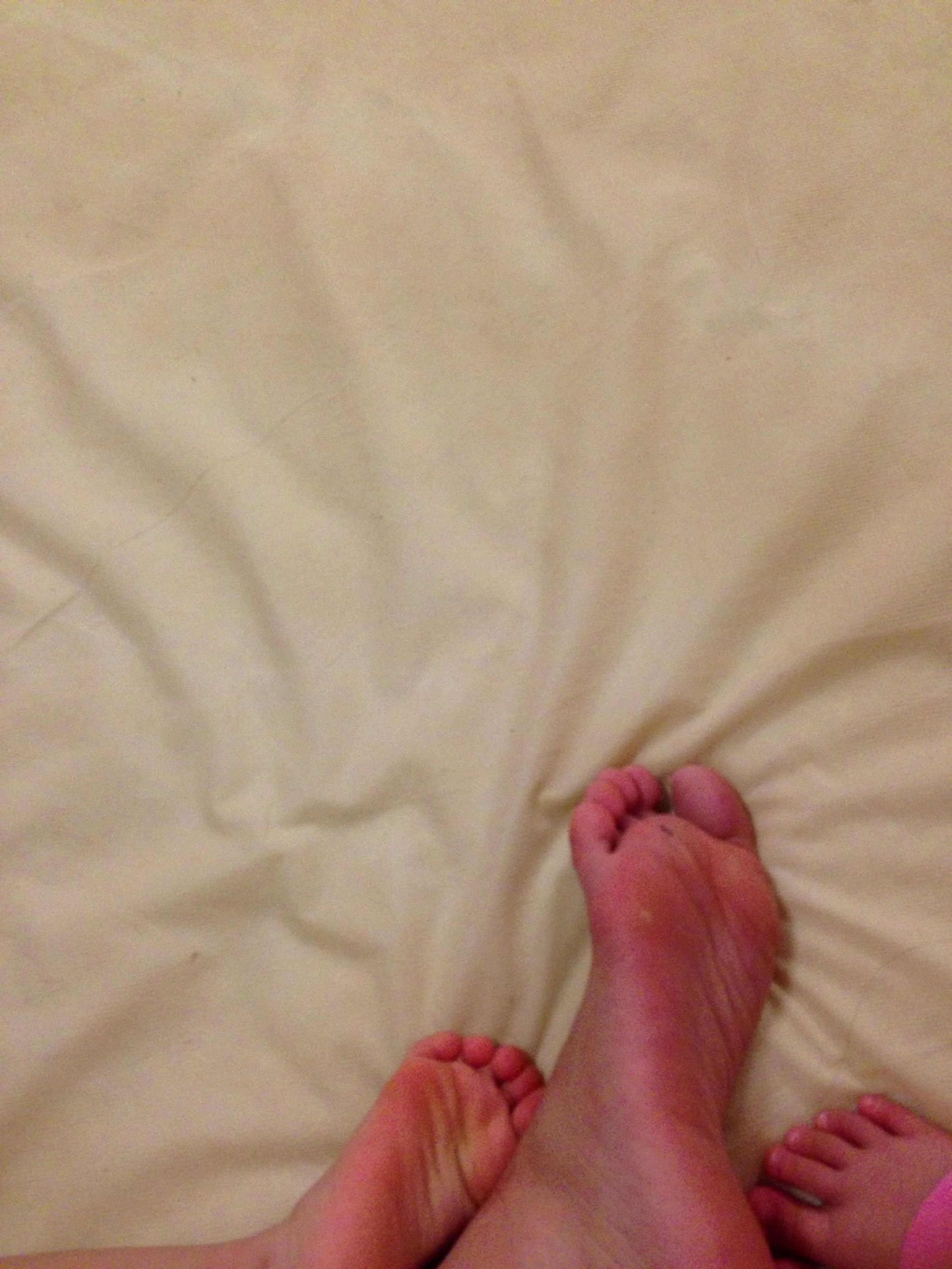 person, personal perspective, part of, lifestyles, barefoot, low section, leisure activity, indoors, human finger, cropped, unrecognizable person, human foot, holding, bed, relaxation