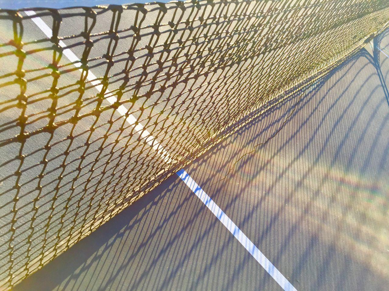 Close-up Day EyeEm New Here Lines Low Angle View No People Shadow Sun Glare Sun Rays Tennis Tennis Court Tennis Net Tenniscourt