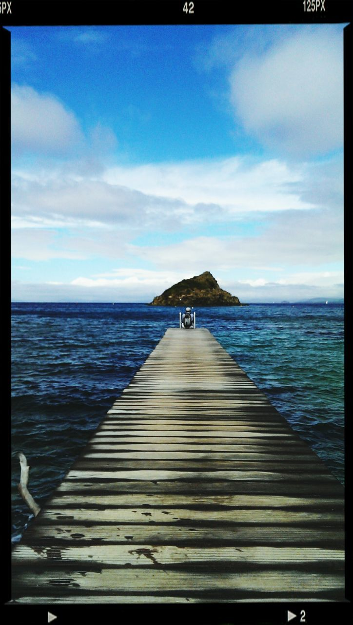 sea, water, horizon over water, sky, tranquil scene, scenics, tranquility, nature, idyllic, beauty in nature, outdoors, day, no people, cloud - sky, jetty, rippled, beach