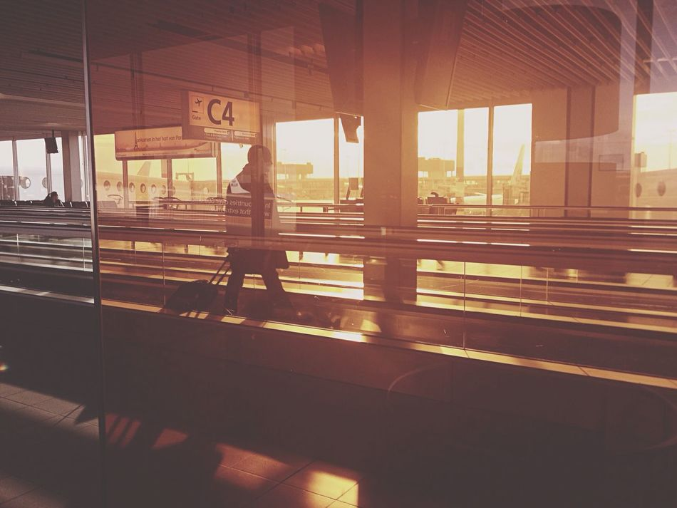 Traveller walking through an escelator at Amsterdam Schipol Airport Architecture Indoors  Window Built Structure Transportation Public Transportation Day One Person City People Amsterdam Schipolairport Mirrior Reflection Holiday Vacations Sightseeing Sunset Shillouette Sunrise Business Man Luggage The Architect - 2017 EyeEm Awards EyeEmNewHere The Street Photographer - 2017 EyeEm Awards
