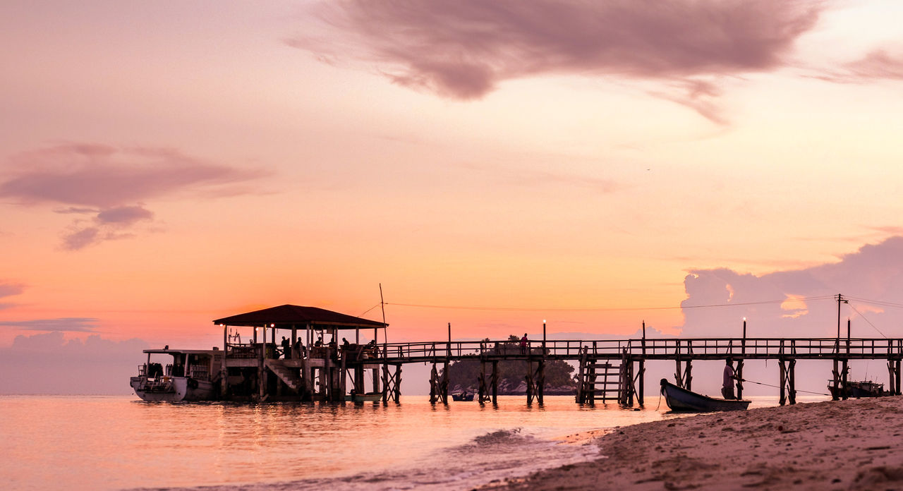Beautiful sunset at Dayang Island in Johor, Malaysia. One of popular diving spot in the country. ASIA Beach Clouds And Sky Golden Hour Island Jetty Johor Malaysia Scubadiving Seascape Shore Sky Sunset Wooden Yellow