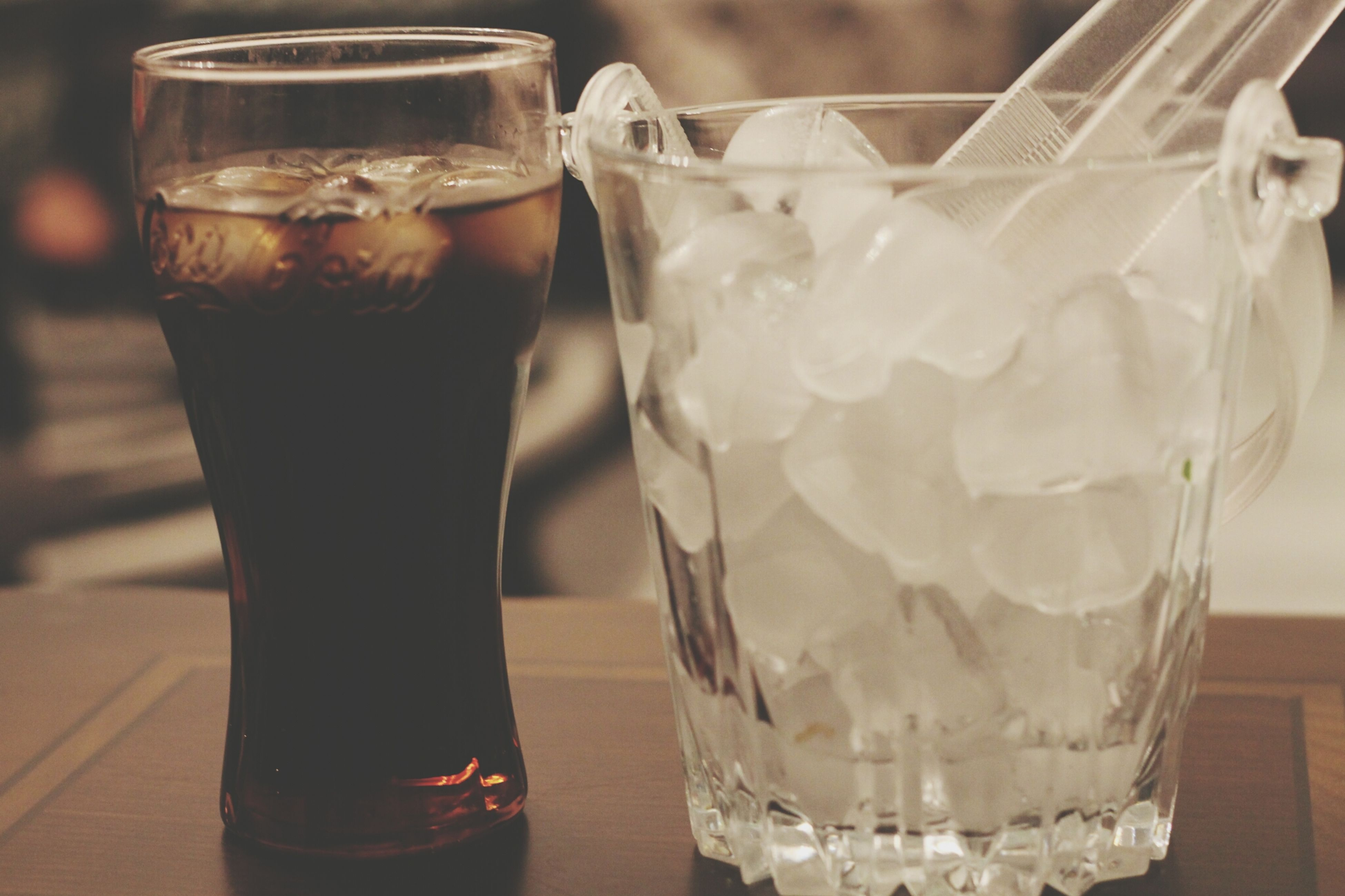 food and drink, drink, refreshment, drinking glass, freshness, indoors, table, close-up, still life, glass - material, cold temperature, ice, alcohol, focus on foreground, transparent, glass, drinking straw, ice cube, beer glass, cocktail