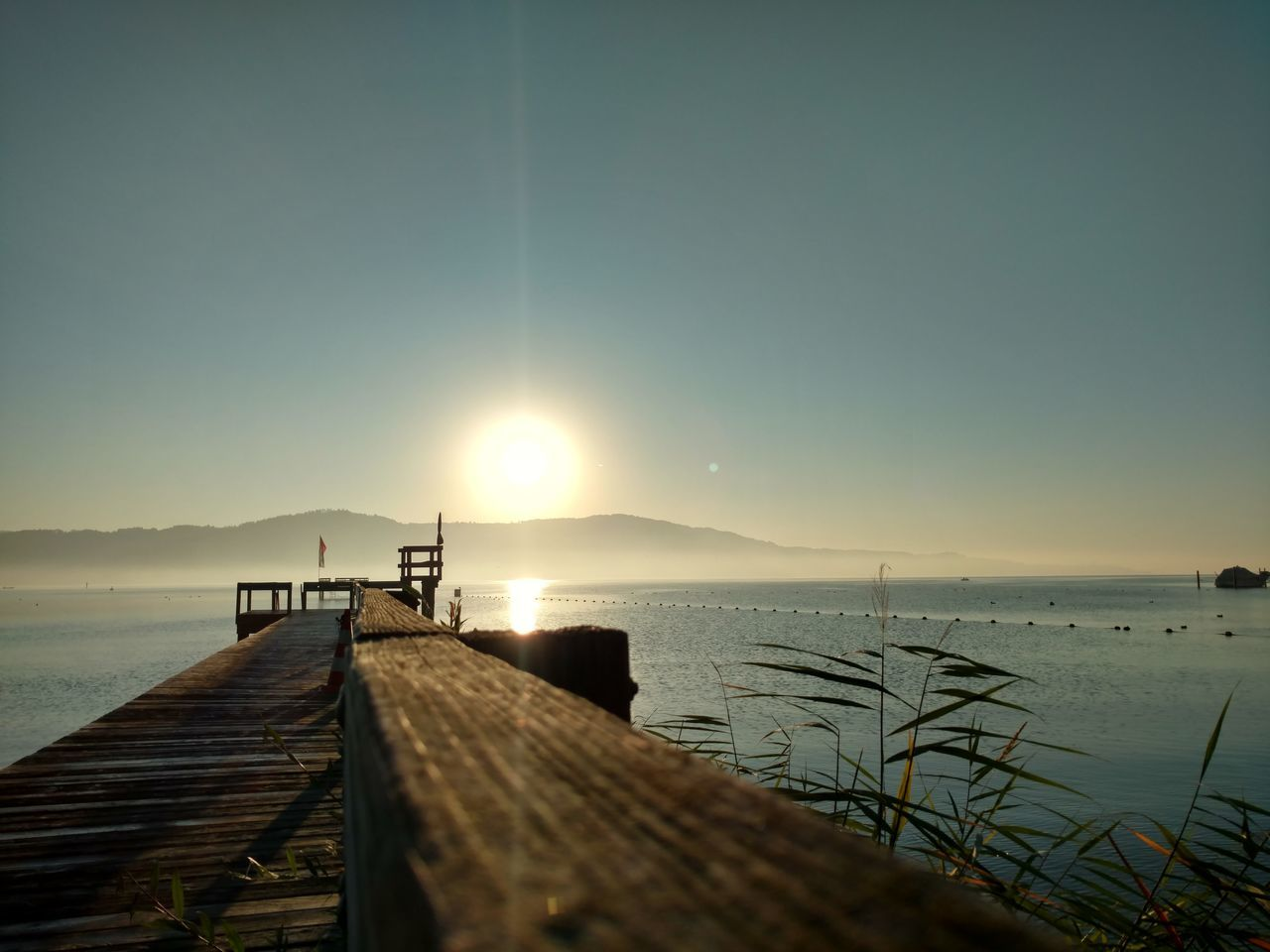 Water Sea Sun Pier Tranquil Scene Tranquility Lake Scenics Reflection Sunbeam Nature Beauty In Nature Day Outdoors Calm Bright Standing Water No People Majestic Remote