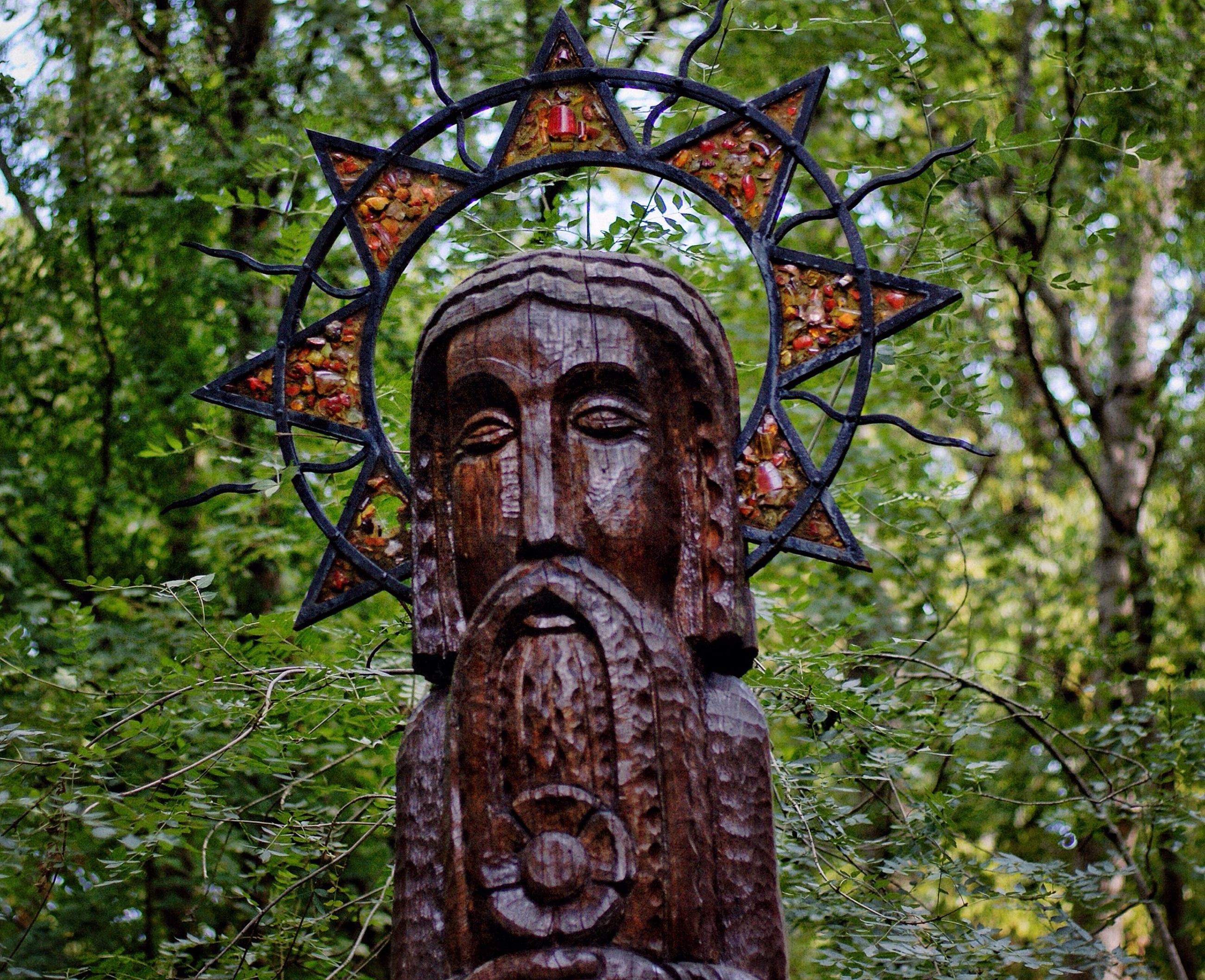 art and craft, human representation, statue, art, sculpture, creativity, tree, carving - craft product, religion, spirituality, low angle view, place of worship, no people, day, old, outdoors, stone material