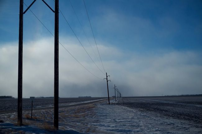 2-12-16 Alternative Energy Atmosphere Atmospheric Mood Connection Electricity  Environment Environmental Conservation Fargo Field Fuel And Power Generation Journey No People North Dakota Outdoors Perspective Renewable Energy Rural Scene Sky Technology West Fargo Wind Power Wind Turbine Windmill