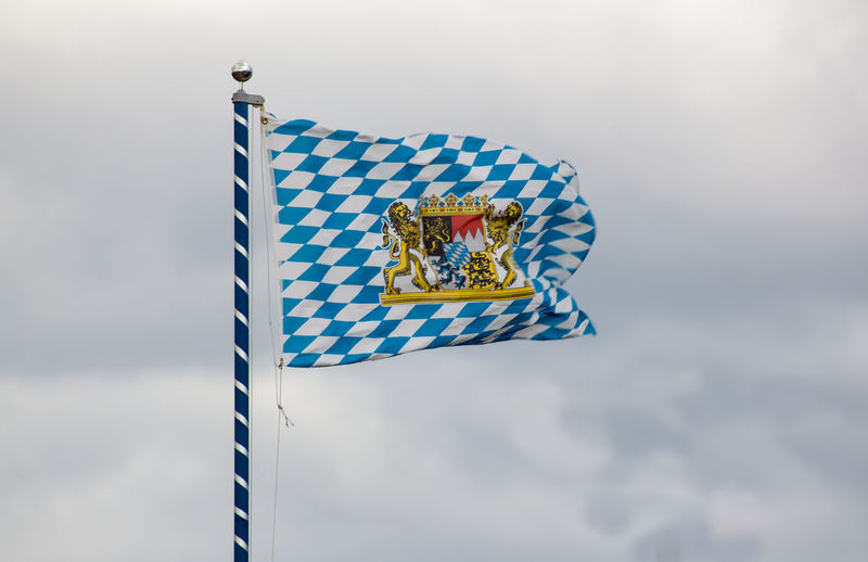 Unofficial Flag of Bavaria with national emblem Bavaria Bavarian Blowing Blue Cloudy Coat Of Arms Cultur Diamond Flag Flag Flagpole Germany Golden Hoisted Banners Identity Lion Mast Multi Colored National Emblem National Flag Patriotism Sign Sky Symbol Tradition Wind First Eyeem Photo