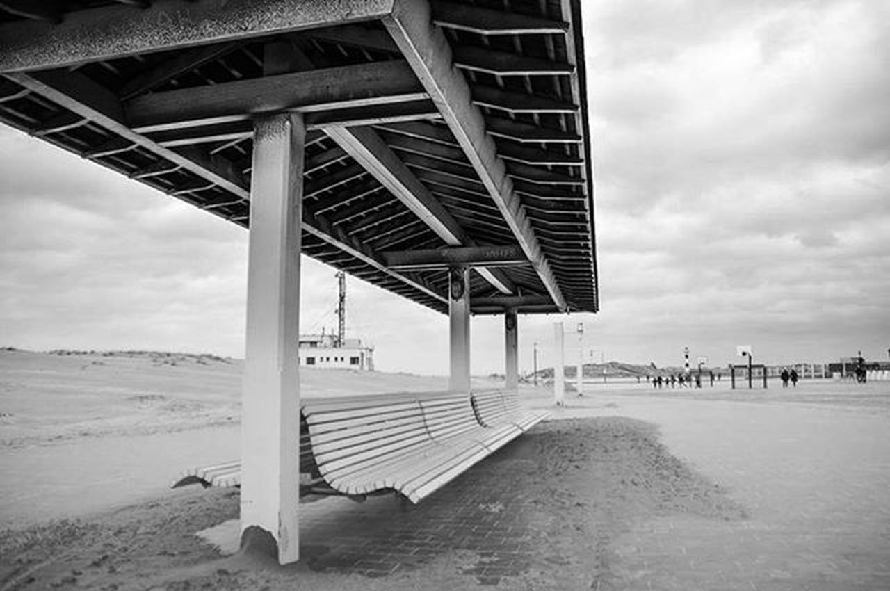 architecture, built structure, transportation, bridge - man made structure, cloud - sky, beach, sky, day, outdoors, water, sea, no people