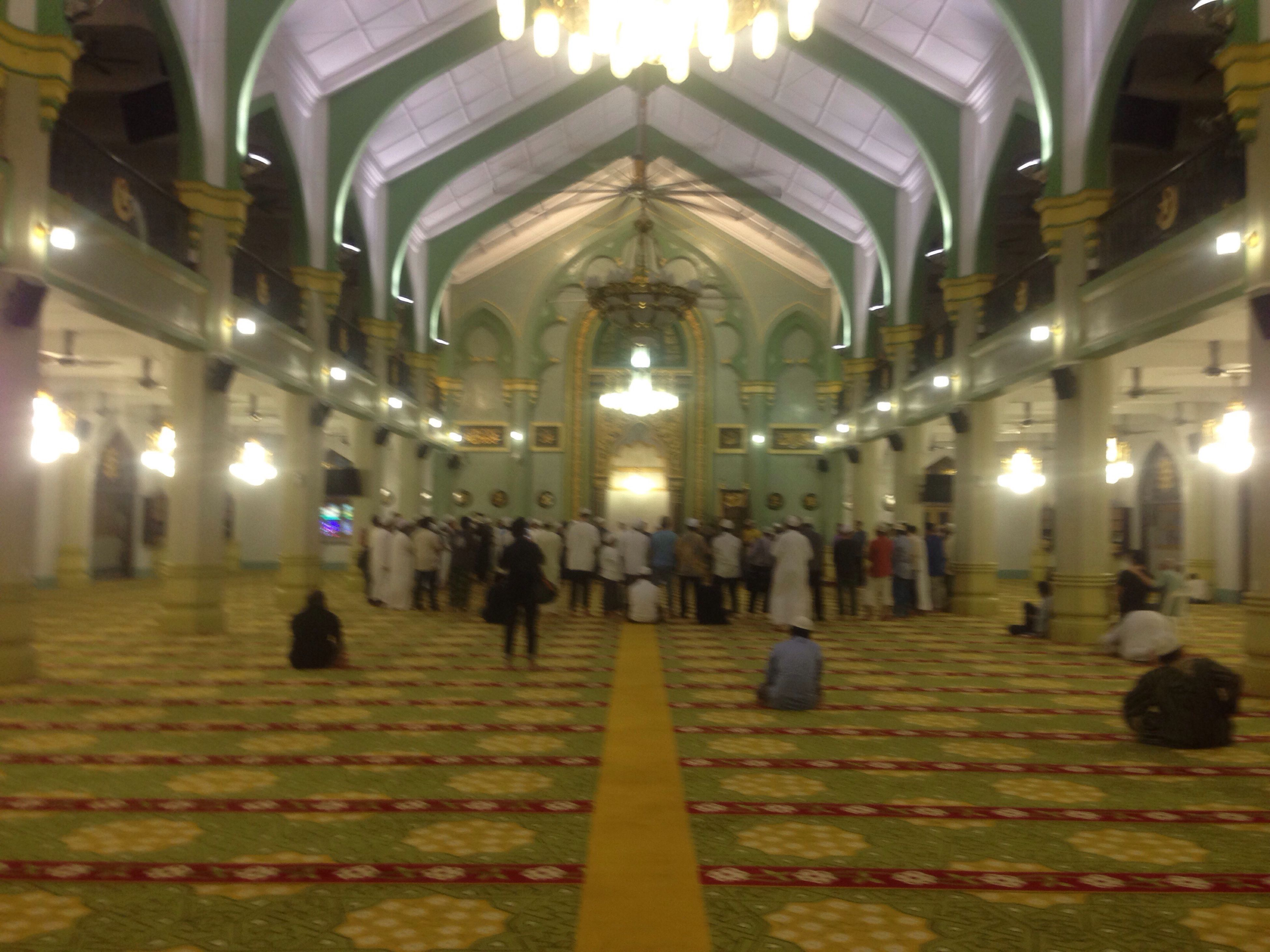 indoors, illuminated, place of worship, religion, spirituality, arch, church, lighting equipment, ceiling, architectural column, architecture, built structure, corridor, pew, person, interior, in a row