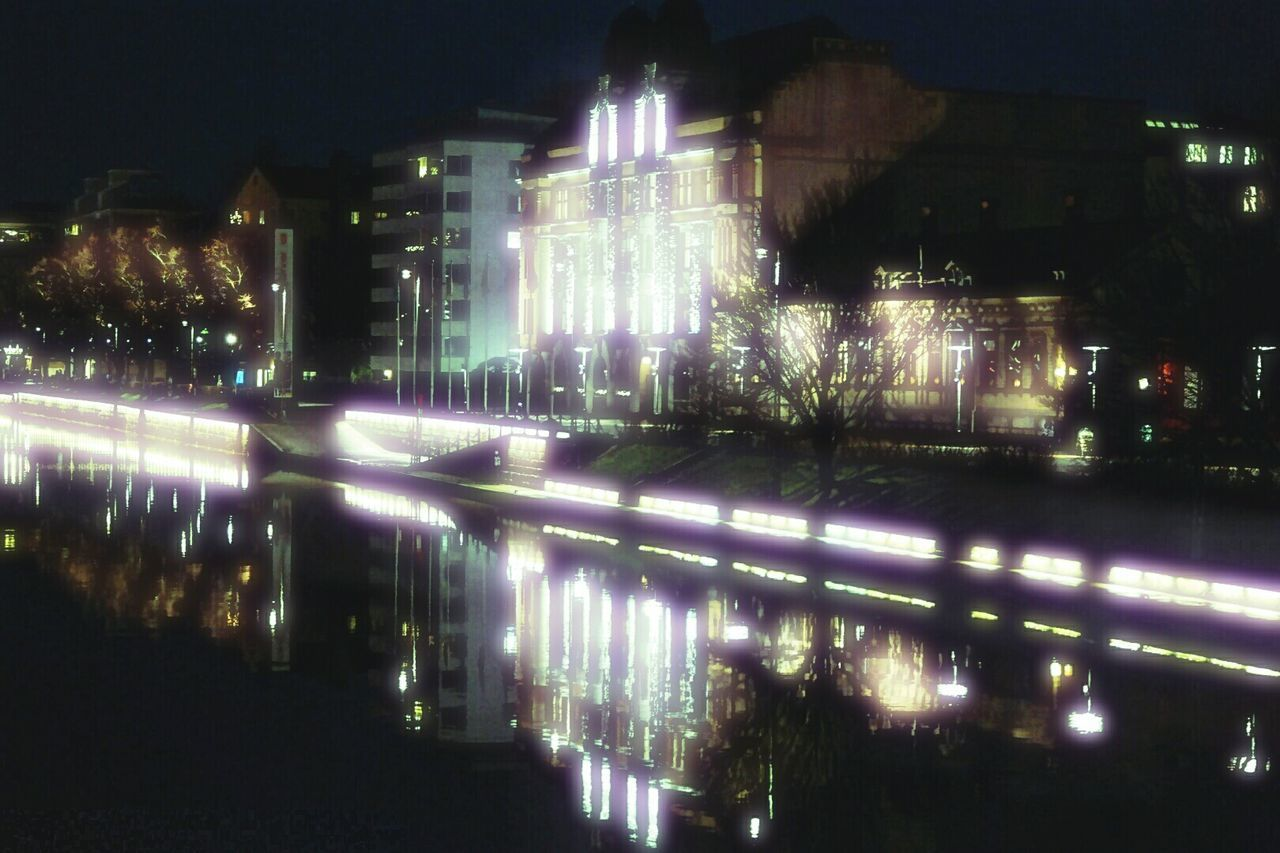 illuminated, night, outdoors, reflection, no people, long exposure, water, building exterior, tree, architecture, nature, city