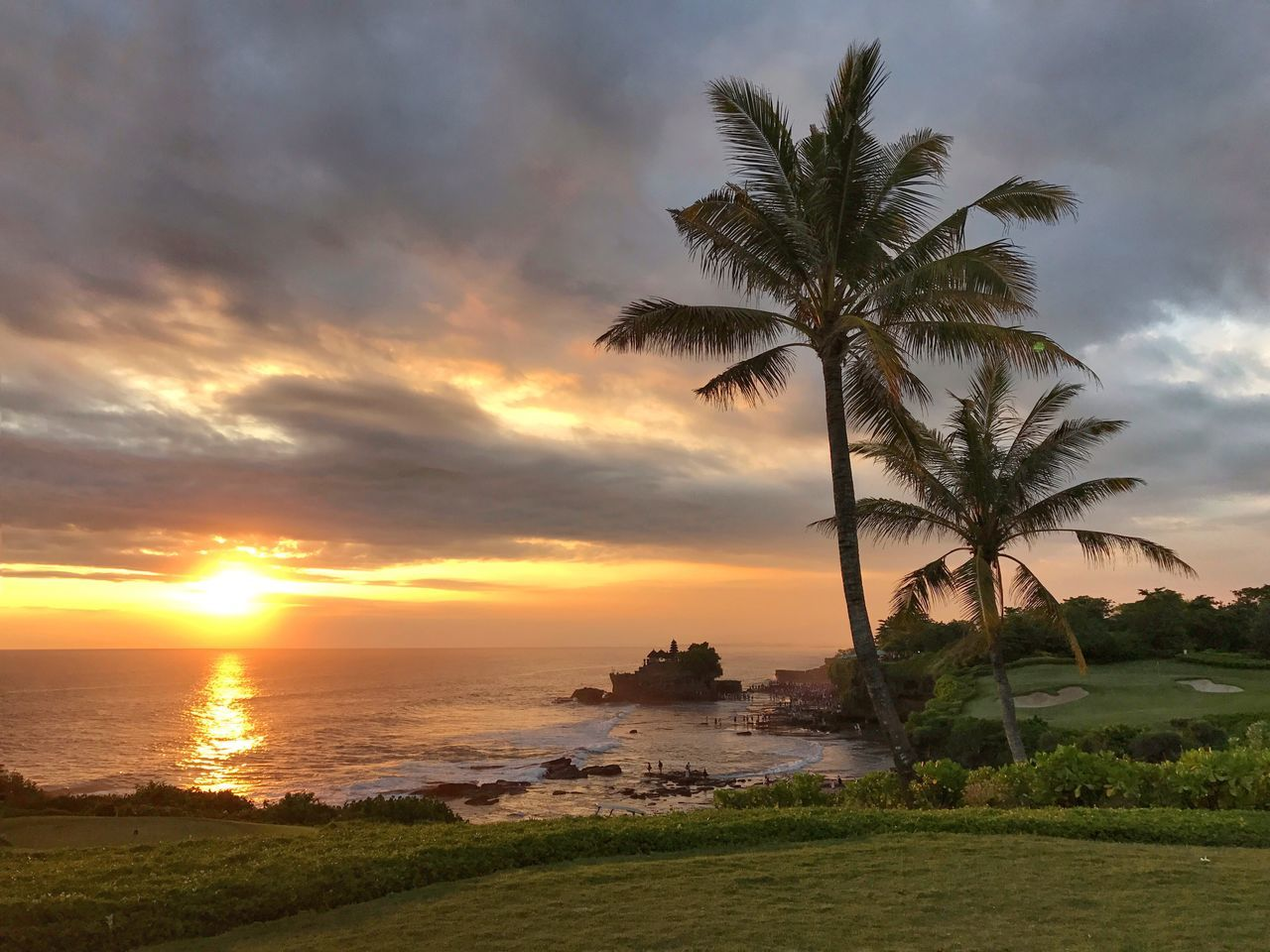 Sunset Palm Tree Sea Beauty In Nature Sky Scenics Nature Cloud - Sky Sun Tranquility Tranquil Scene No People Horizon Over Water Outdoors Bali, Indonesia Travel Destinations Tanah Lot