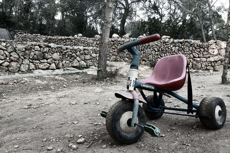Abandoned kids bike Bike Trike Kids Abandoned Old Retro Children's Bike Natural Stones Countryside Outdoors Nursery Telling Stories Differently