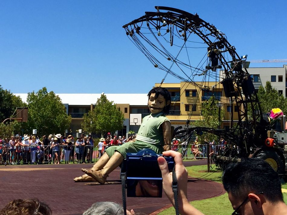 PERTH, AUSTRALIA-FEBRUARY 14, 2015: Journey of the Giants, Giant Marionette Diver and Little Girl with Crowds, public International Arts Festival Art Art Event Arts Festivals Australia Belts And Pulleys City Cityscape Crane Crowds Culture Festival Giant Human International Journey Little Girl Marionette Marionette Sitting People Perth Puppeteers Walking Wooden