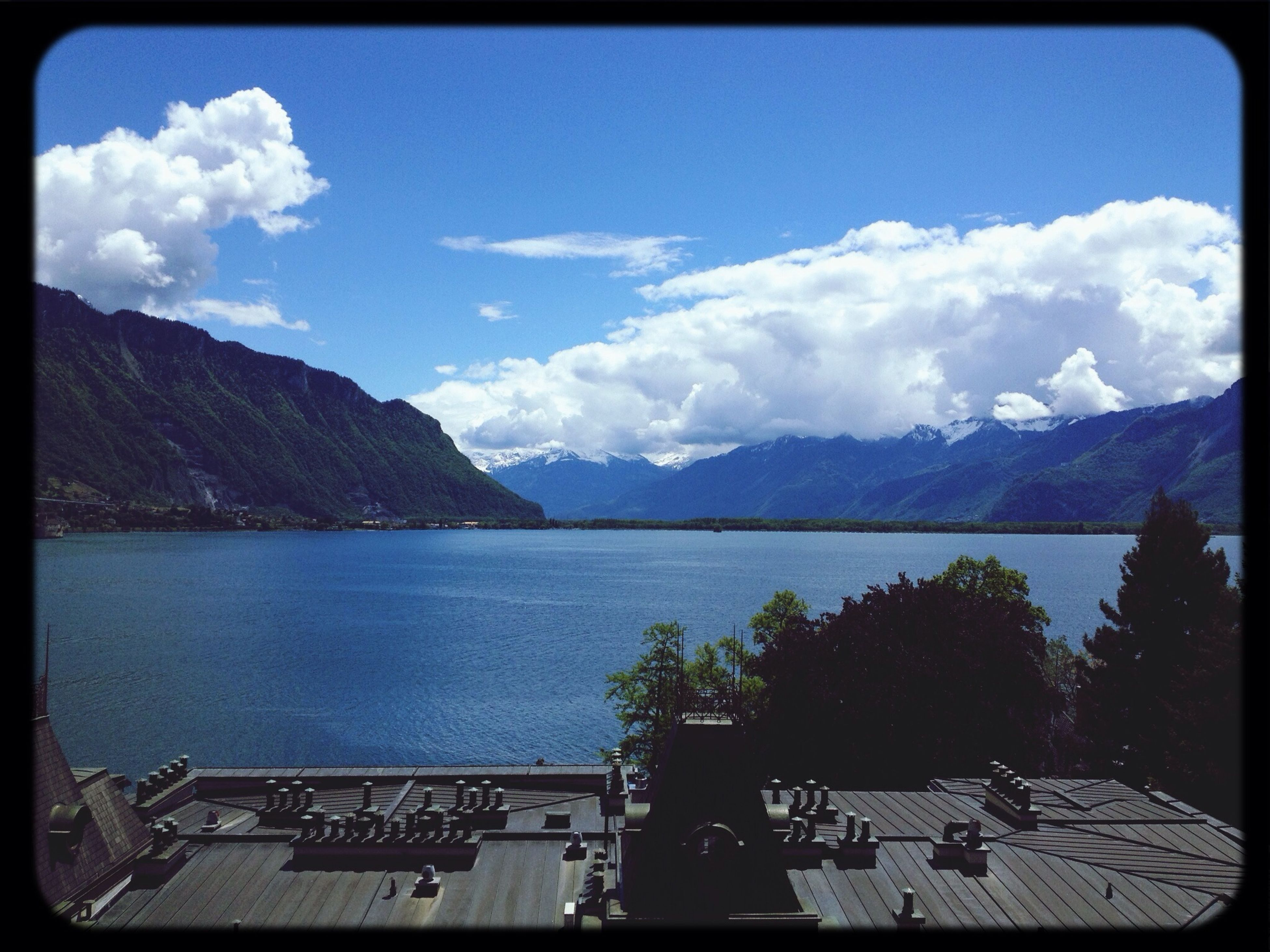 mountain, transfer print, sky, mountain range, water, scenics, tranquil scene, tranquility, lake, cloud - sky, auto post production filter, beauty in nature, cloud, nature, idyllic, cloudy, railing, outdoors, day, tree