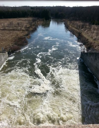 Shot From Above  Water Discharge from Dam Sluice