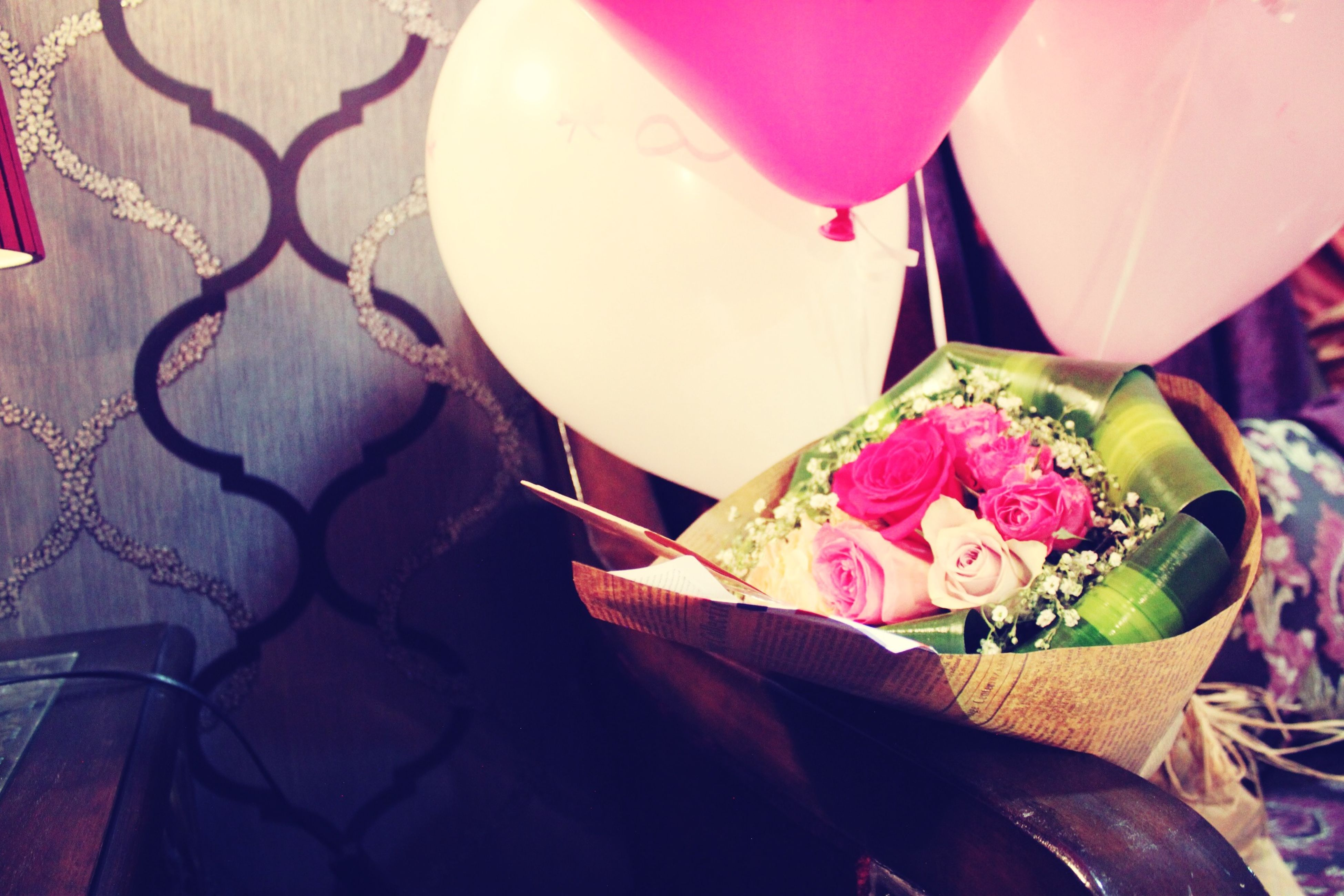 indoors, pink color, table, close-up, flower, high angle view, still life, multi colored, decoration, no people, freshness, day, sunlight, chair, hanging, focus on foreground, petal, paper, rose - flower