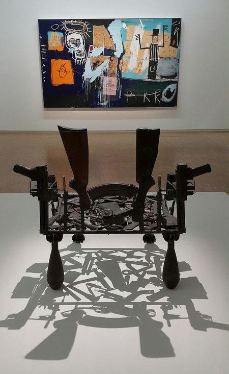 Gonçalo Mabunda's Tribal Throne made from Gun parts throws interesting Shadows. On the wall is Basquiat's Slave Auction Modern Art Basquiat Art Gallery Paris Centre Pompidou Fine Art Photography The City Light