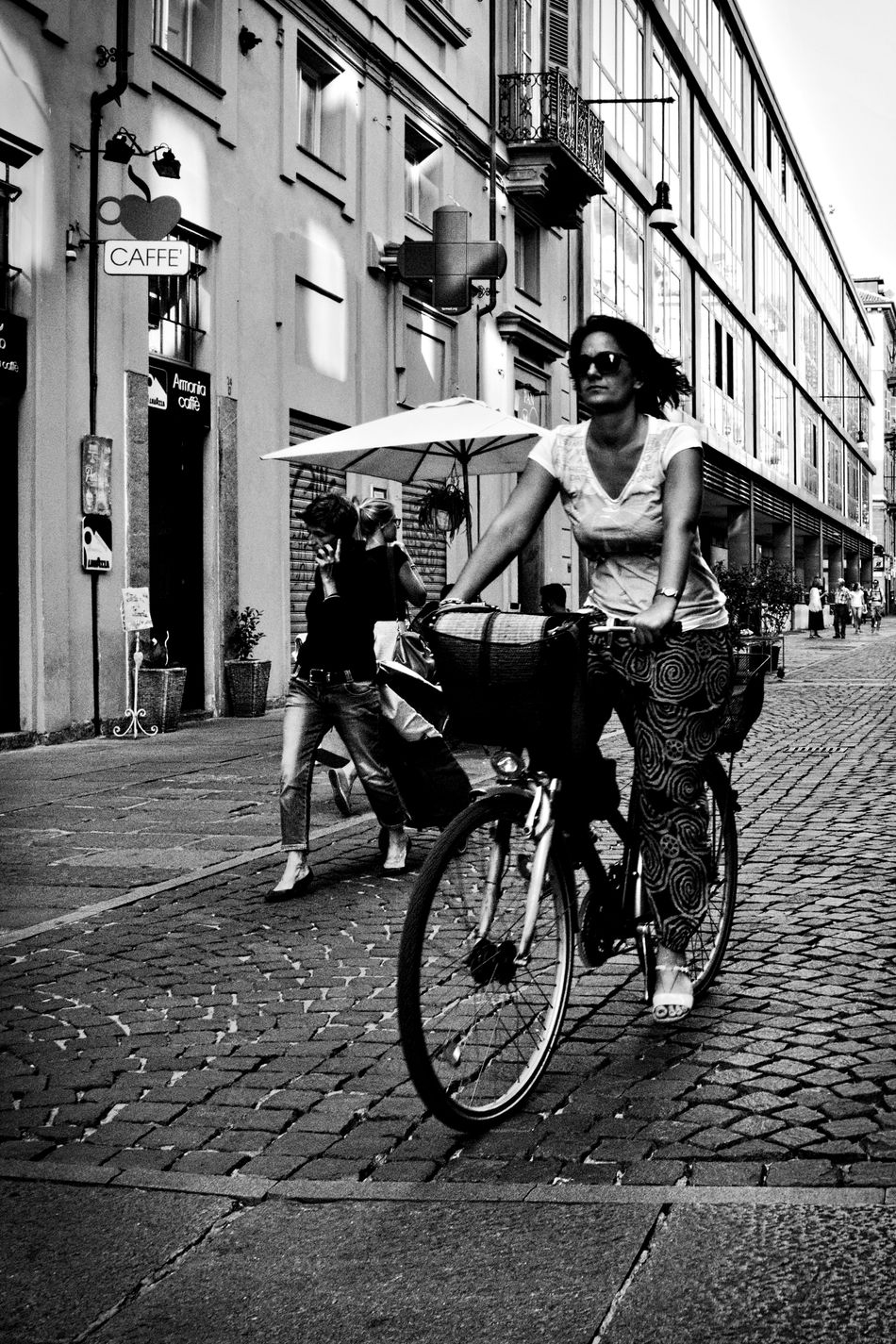 City rider. Adult Bicycle Bicycle Rider Bike Black And White Black And White Photography Bnw City City Life Lifestyles Olympus Om-d E-m10 Outdoors People Person Street Street Life Street Photography Torino Italy Transportation Transportation Vehicle Turin Turin Italy Walking People Young Women Monochrome Photography