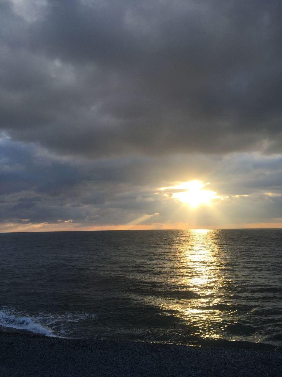 Colorful Sea Cloud - Sky Beauty Sky Cloud Sun Sunbeam Beauty In Nature Water Blue Day Dramatic Sky Dark Clear Sky Shining No People Lens Flare