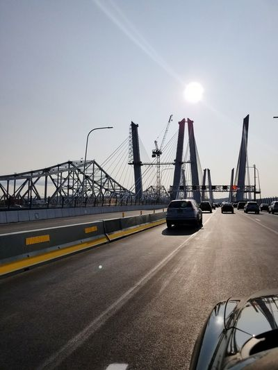 First day of this new bridge. The old Tappan Zee bridge can be seen on the left Crane - Construction Machinery Transportation Day Outdoors No People Bridge Newtappanzeebridge Tappanzee Bridge Mariocuomobridge Hudsonriver Sun Sky Structure Newbridge Cables