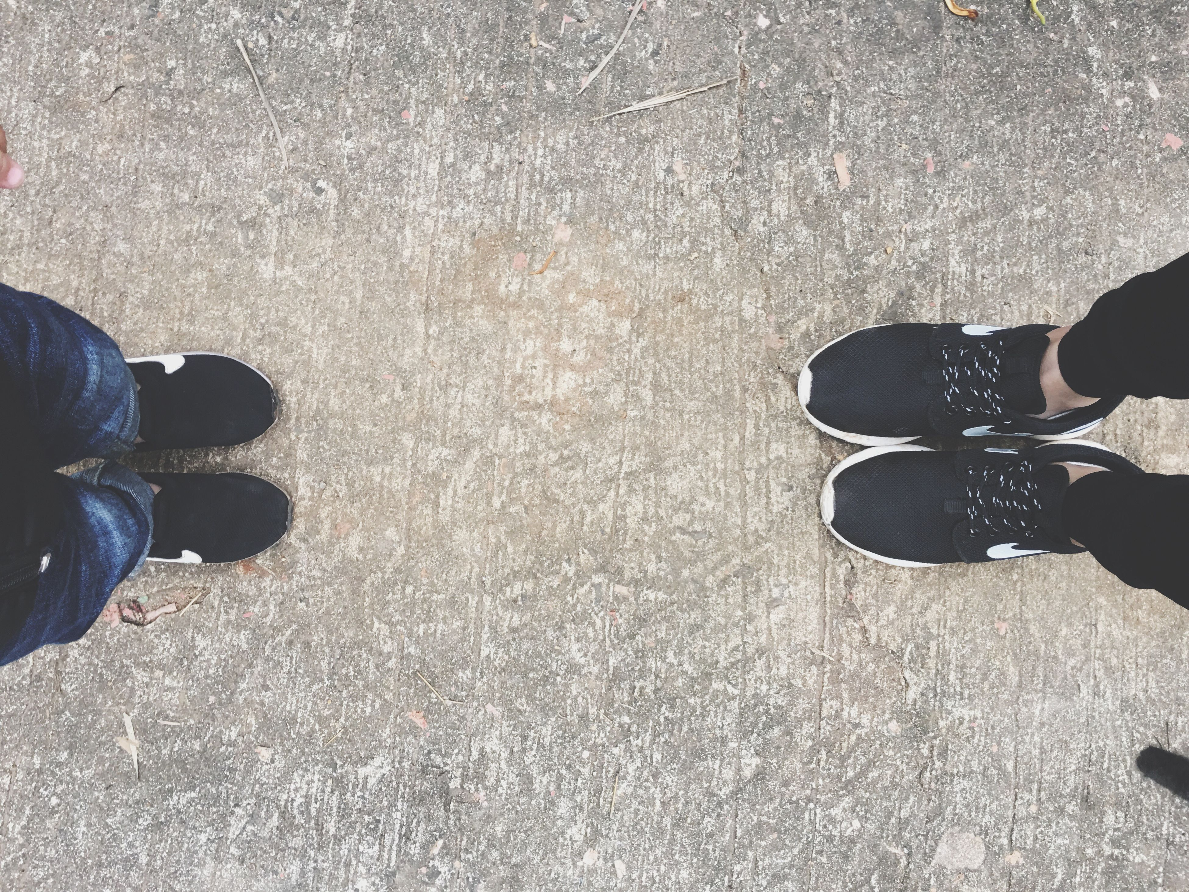 low section, person, lifestyles, shoe, standing, leisure activity, personal perspective, human foot, high angle view, men, street, unrecognizable person, footwear, asphalt, road, part of