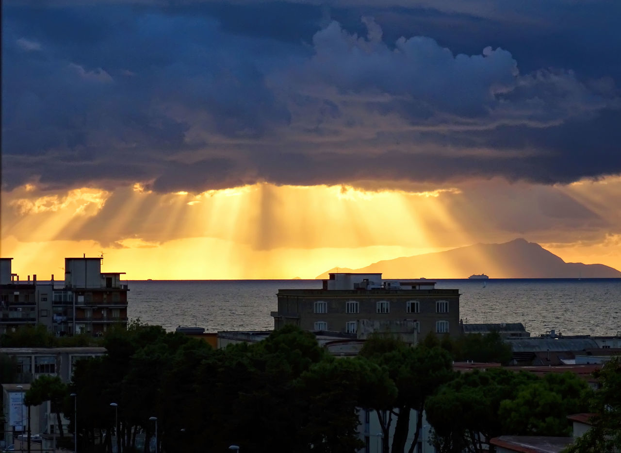 Ischia vista da Castellammare di Stabia Architecture Atmosphere Atmospheric Mood Beauty In Nature Building Exterior Built Structure City Cloud Cloud - Sky Cloudscape Dramatic Sky Environment Majestic Mountain Orange Color Rainbow Scenics Sky Storm Storm Cloud Sunbeam Sunlight Sunset Tree Weather