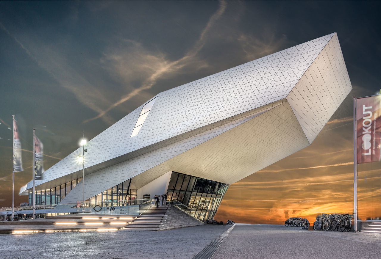 Amsterdam Architecture Bridge - Man Made Structure Building Exterior Built Structure City Cloud - Sky Day Eye Filmmuseum Illuminated Low Angle View Modern No People Outdoors Sky Transportation
