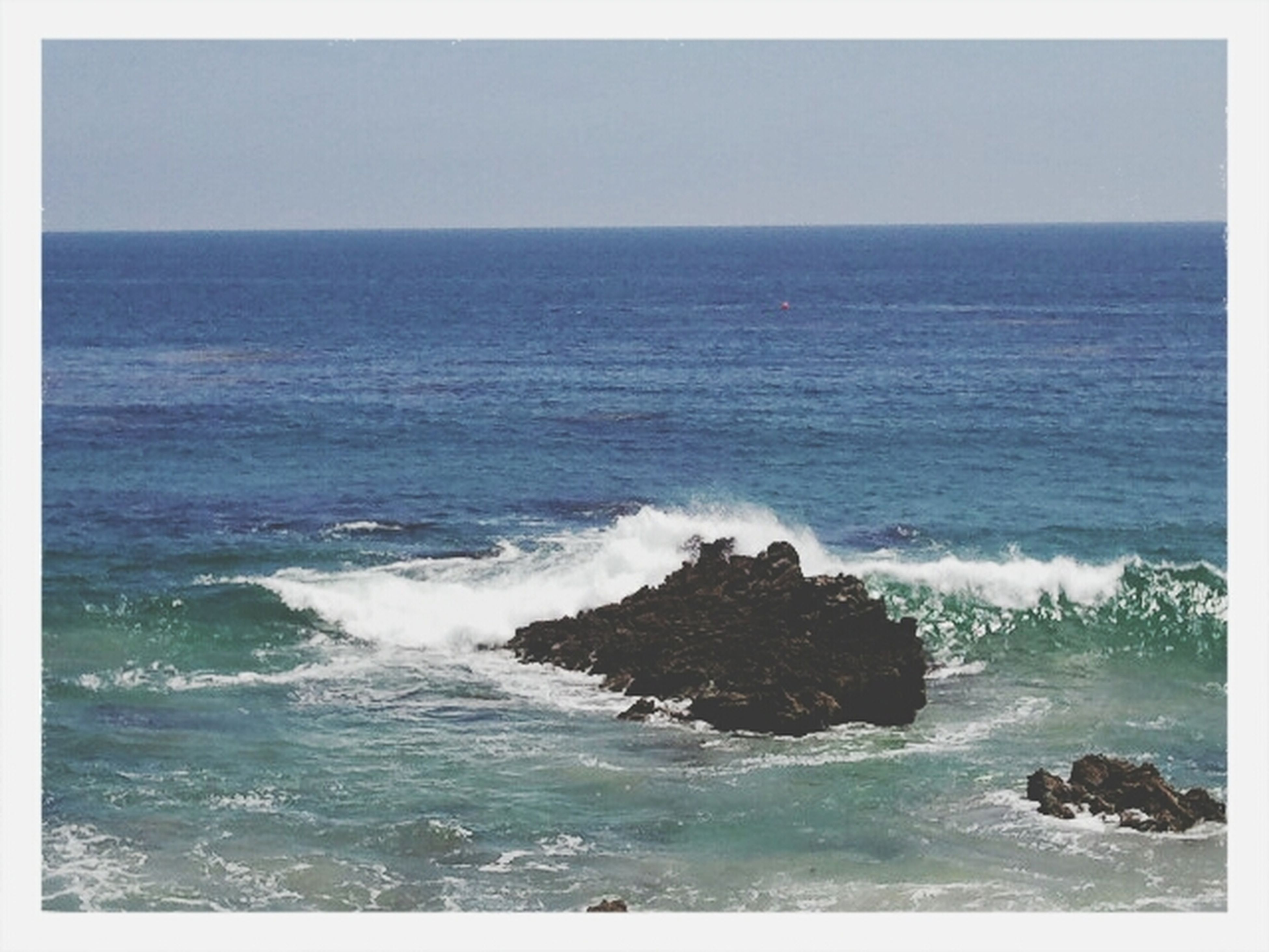 sea, water, horizon over water, transfer print, wave, scenics, beauty in nature, surf, tranquil scene, clear sky, nature, auto post production filter, tranquility, seascape, rock - object, idyllic, rock formation, beach, motion, shore