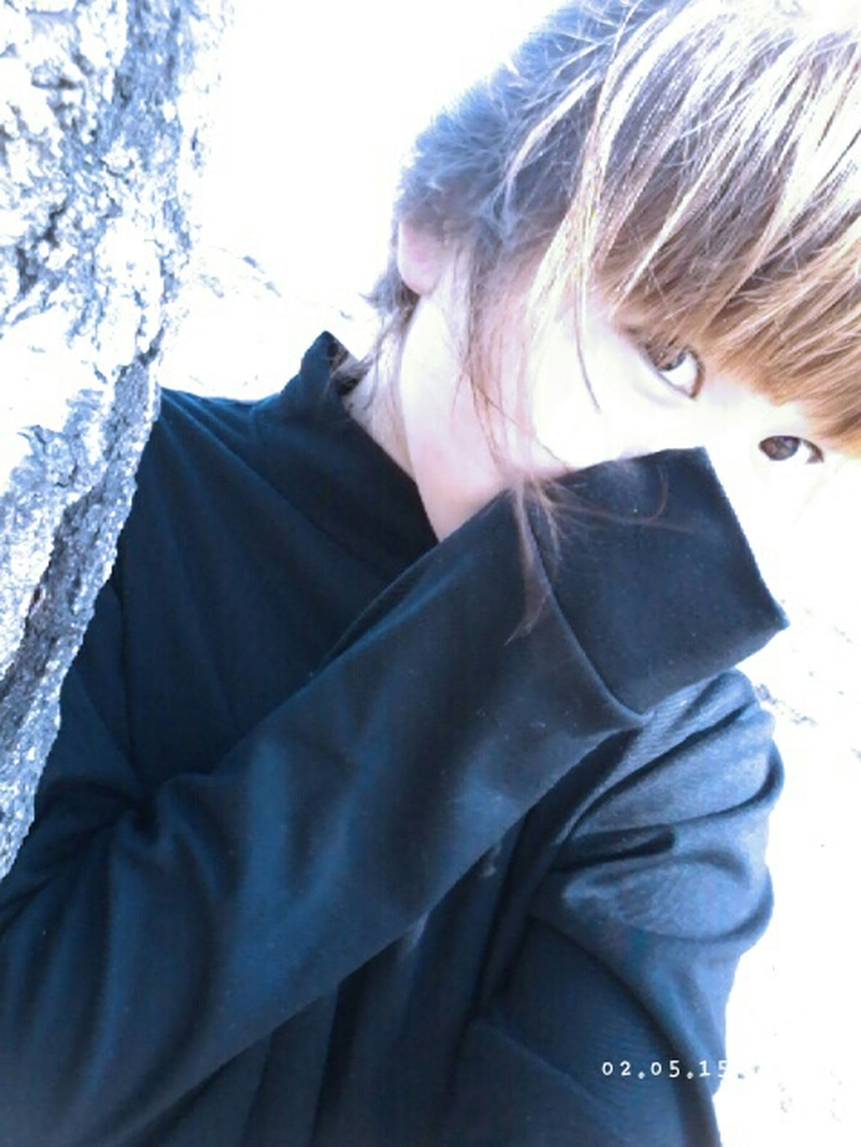 lifestyles, casual clothing, leisure activity, young adult, headshot, person, young women, waist up, warm clothing, long hair, rear view, winter, front view, sitting, day, jacket, looking down, side view