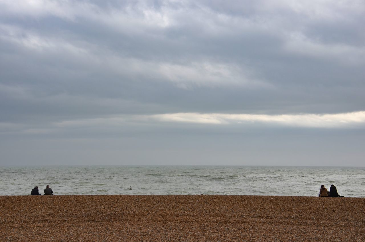 The Separated Togetherness Sea Water Beach Horizon Over Water Sky Nature Real People Beauty In Nature Scenics Cloud - Sky Tranquility Outdoors Idyllic Tranquil Scene Leisure Activity Day Togetherness People Stoney Beach Togetherness Separation Beach Scene  Brighton United Kingdom