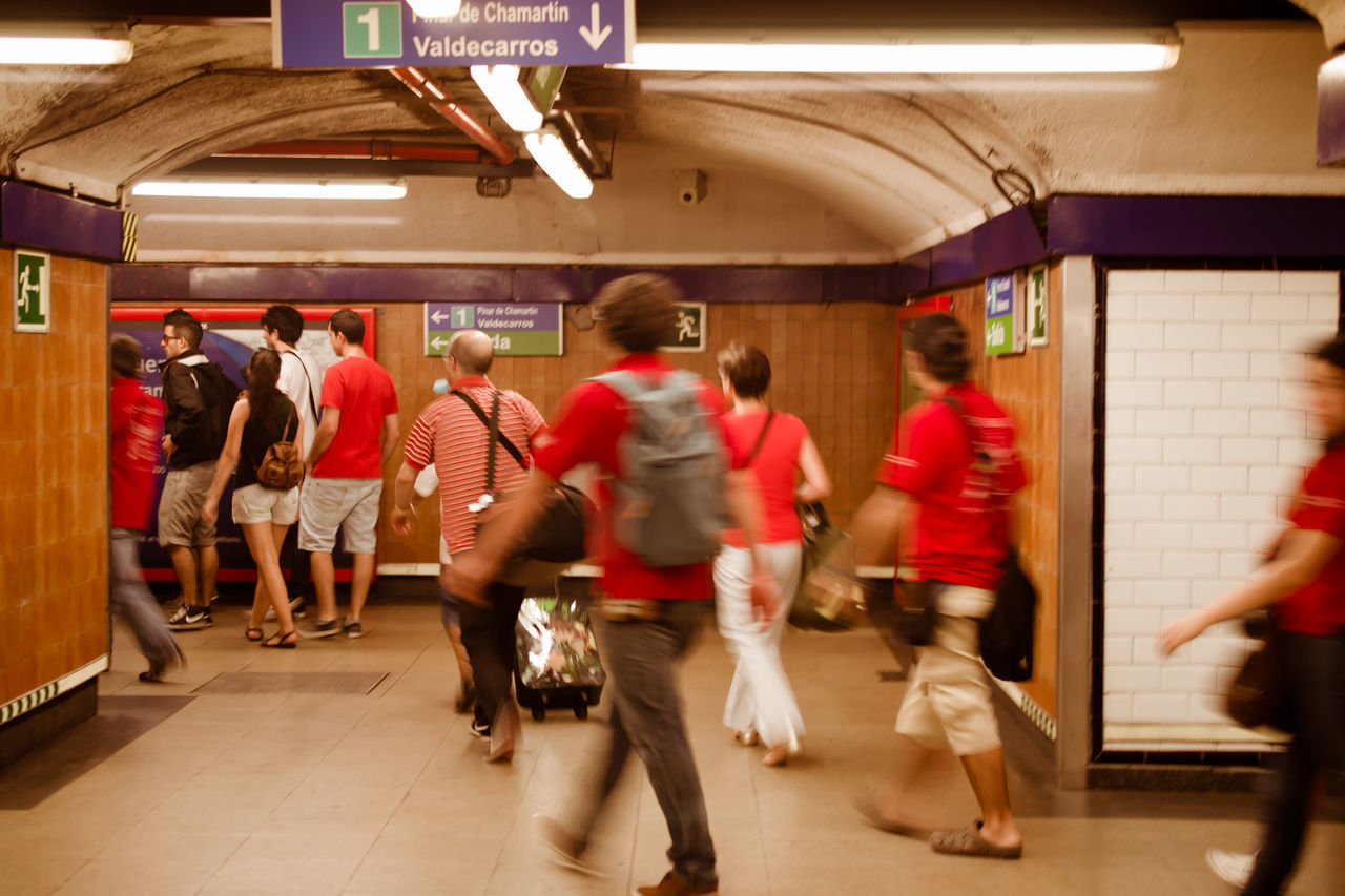 blurred motion, real people, public transportation, walking, men, motion, large group of people, women, transportation, indoors, subway station, illuminated, full length, day, people
