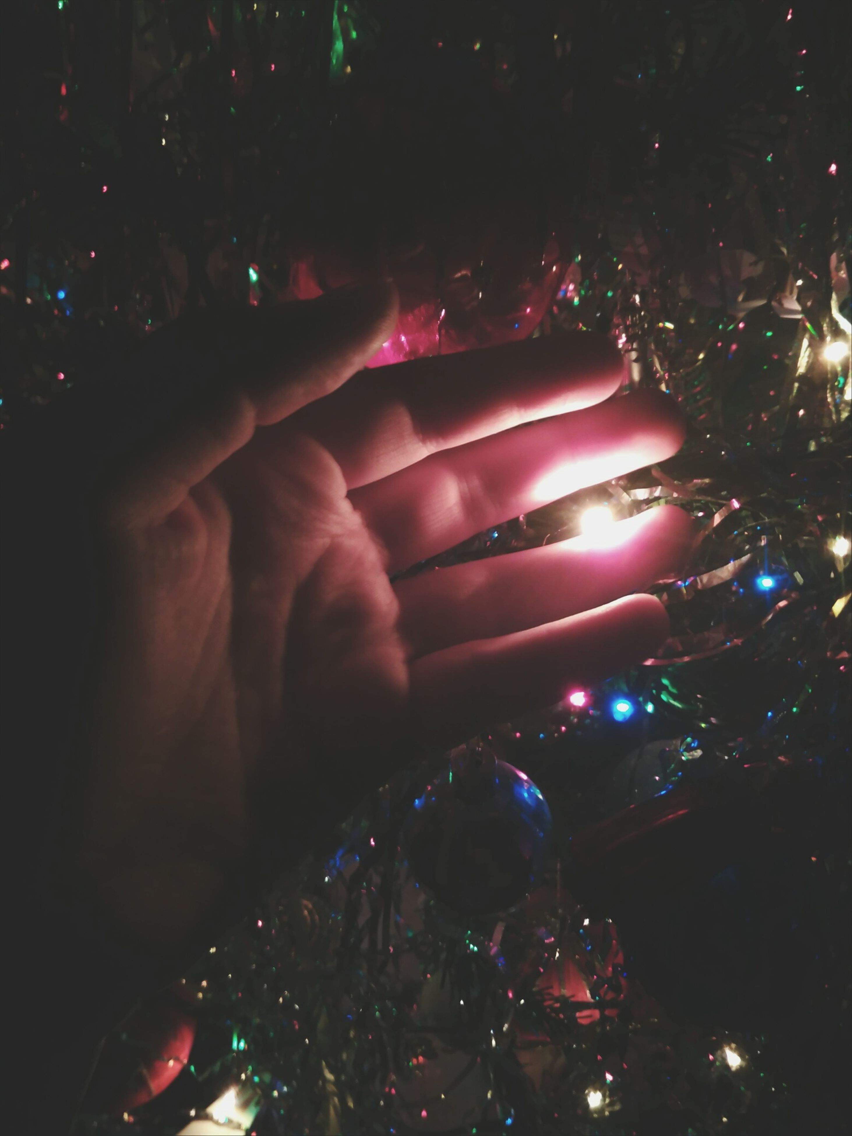 human hand, illuminated, multi colored, human body part, celebration, celebration event, people, indoors, real people, night, adults only, light effect, close-up, adult