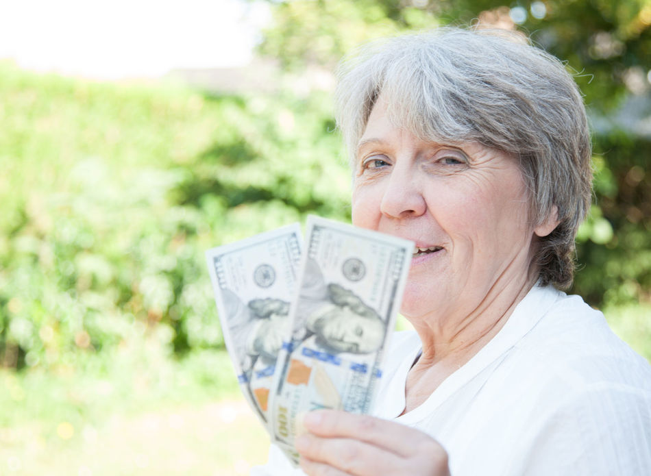 Old age woman holding US dollar notes Grandmother Granny Money Old Age People Old Woman Outside Pocket Money Portrait Portrait Of A Woman Retirement Retirement Home Senior Senior Adult Senior Portrait Spending Money US Dollar