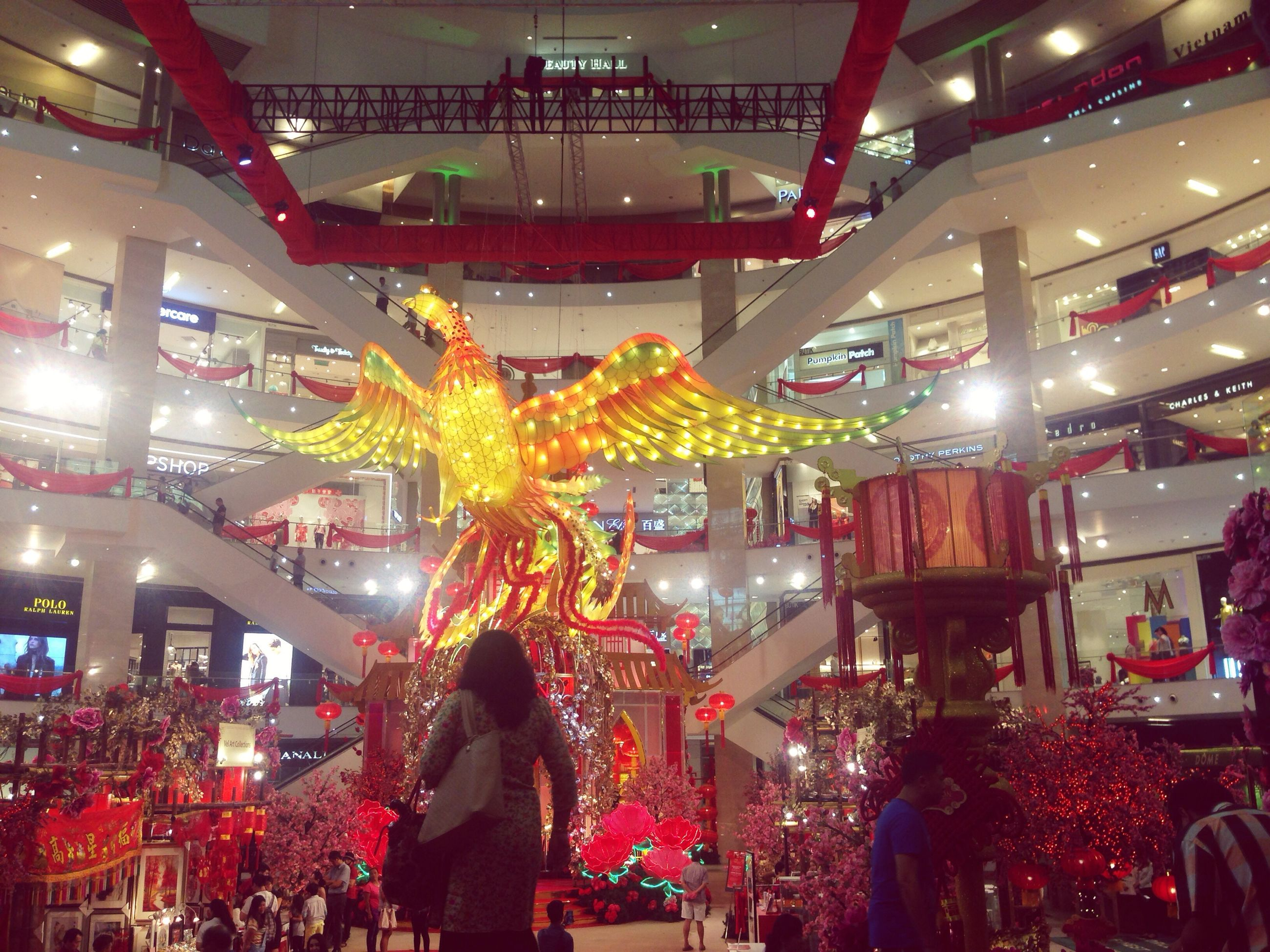 cultures, chinese new year, celebration, large group of people, architecture, travel destinations, built structure, chinese lantern festival, new year's eve, illuminated, people, annual event, outdoors, chinese dragon