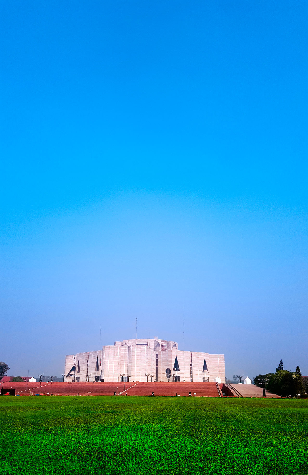 National Parliament House of Bangladesh by #architect #LouisKahn Built Structure Architecture Building Exterior Sky Clear Sky Grass Outdoors Landscape Cityscape No People Day Nature Skyline National Assembly Of Bangladesh EyeEmPaid EyeEmArt EyeEm Gallery EyeEmNewHere EyeEm Nature Lover Break The Mold EyeEmDiversity Eye4photography  Portrait EyeEm Sunnyday☀️ EyeEmNewHere Break The Mold The Great Outdoors - 2017 EyeEm Awards