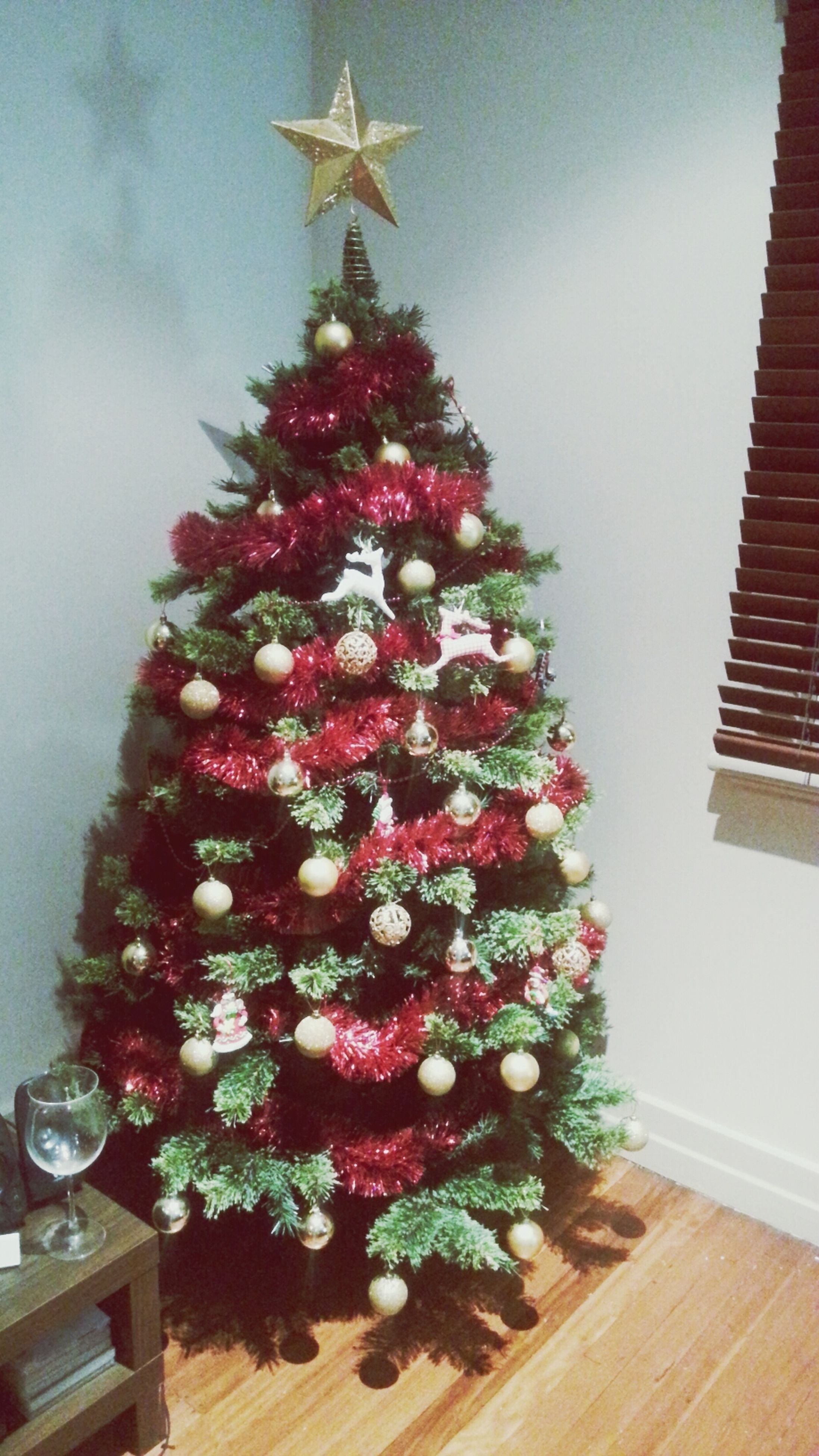 indoors, decoration, flower, christmas, celebration, christmas decoration, hanging, table, christmas tree, decor, home interior, freshness, tradition, still life, architecture, built structure, no people, low angle view, close-up, vase
