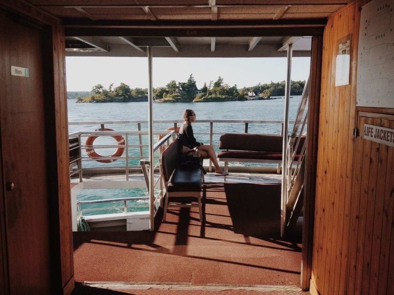 real people, leisure activity, one person, nautical vessel, sea, water, lifestyles, vacations, standing, day, transportation, side view, relaxation, indoors, full length, men, sitting, women, architecture, nature, sailing, boat deck, young adult, sky, adult, adults only, people
