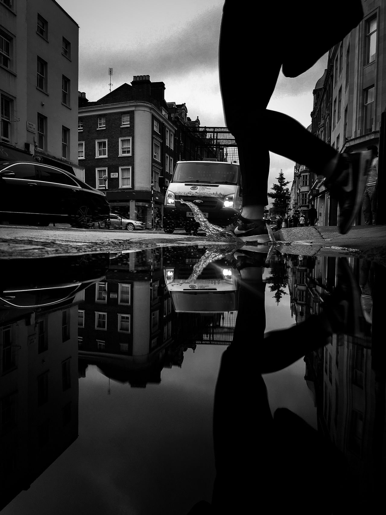 London From The Gutter Street Photography Pedestrian Splashing Puddle The Week Of Eyeem Sillouettes Fresh On Eyeem  Fine Art Photography EyeEm Best Shots EyeEm Masterclass EyeEmBestPics EyeEm Best Shots - Black + White Reflections Eyeemphotography EyeEm Best Shots - The Streets Urban EyeEm Best Shots - Architecture Darkness Atmospheric Lamposts Architecture Fine Art Urban Exploration Eyem Best Shots