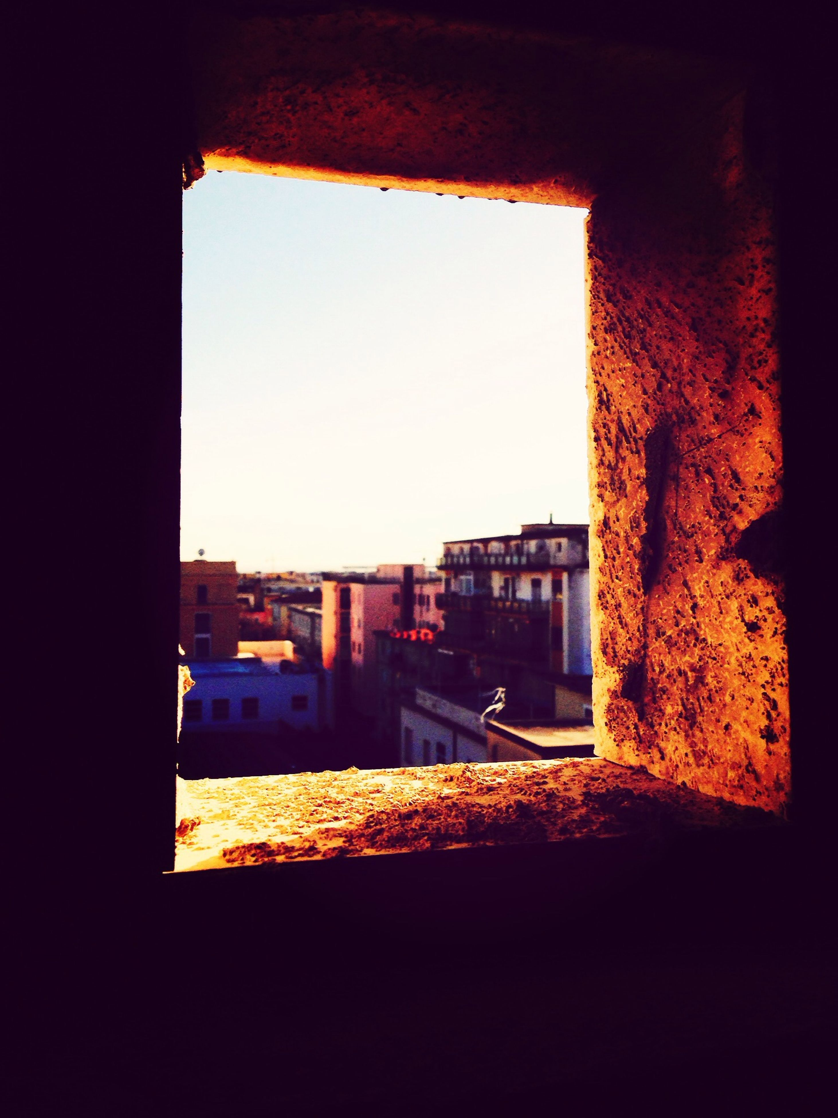 architecture, built structure, indoors, window, building exterior, dark, house, building, low angle view, residential structure, old, sunlight, residential building, no people, history, silhouette, abandoned, clear sky, wall - building feature, day