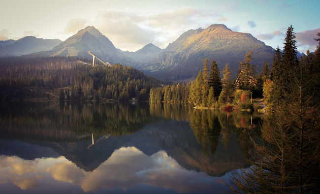 High Tatras Strbske Pleso Strbskepleso Slovakia Mountains Lakes  Miror Reflect Hotels And Resorts Popular Place Autumn Walking Around Hikingadventures Ski Resort  Visiting Forest National Park Climbing A Mountain Taking Photos Picture Of The Day Evening Sun Eveningwalk Relaxing Trip Photo Picture Love Day