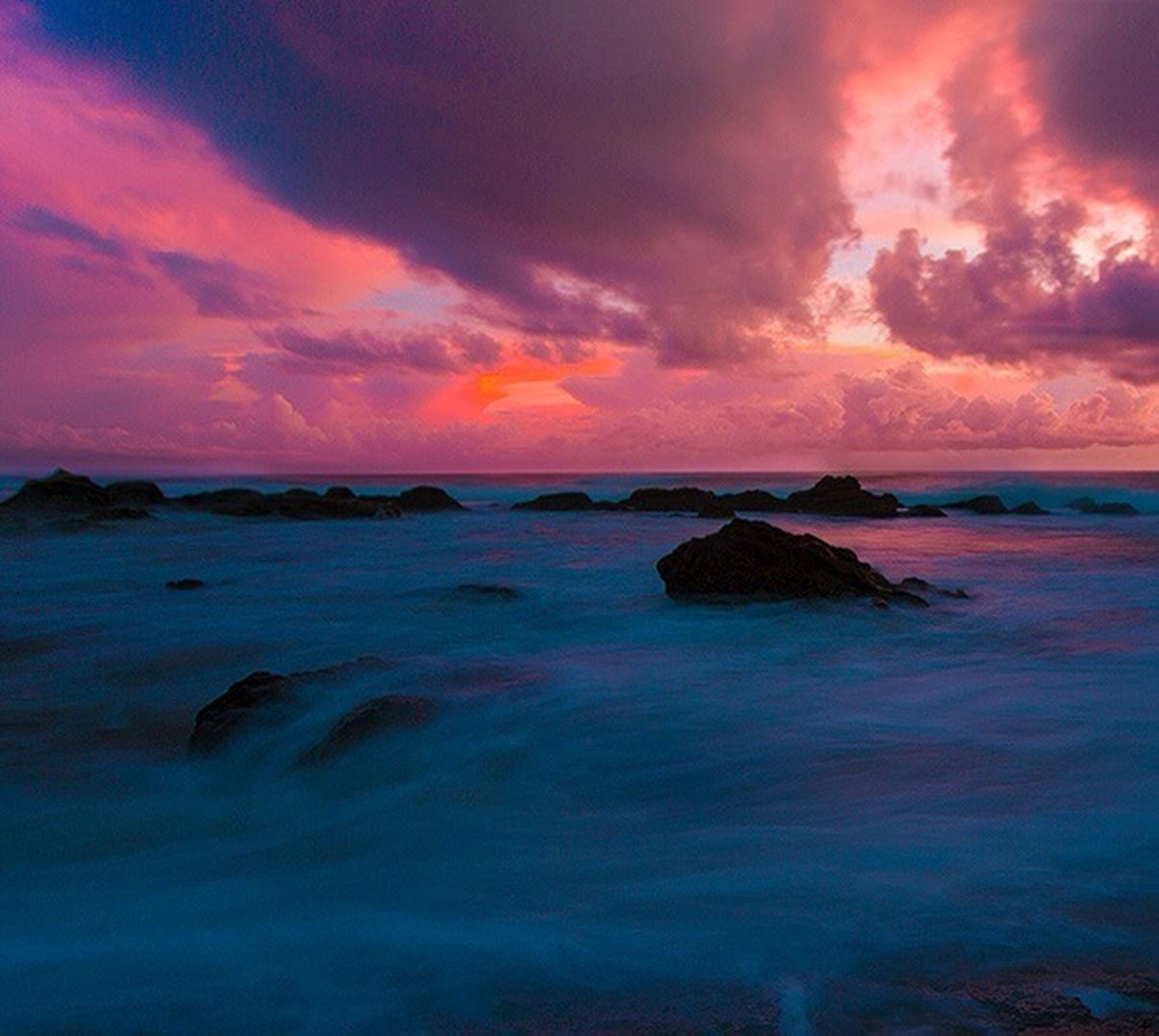 sea, water, sunset, scenics, sky, beauty in nature, horizon over water, tranquil scene, tranquility, cloud - sky, nature, idyllic, orange color, waterfront, dramatic sky, cloudy, rock - object, beach, cloud, dusk