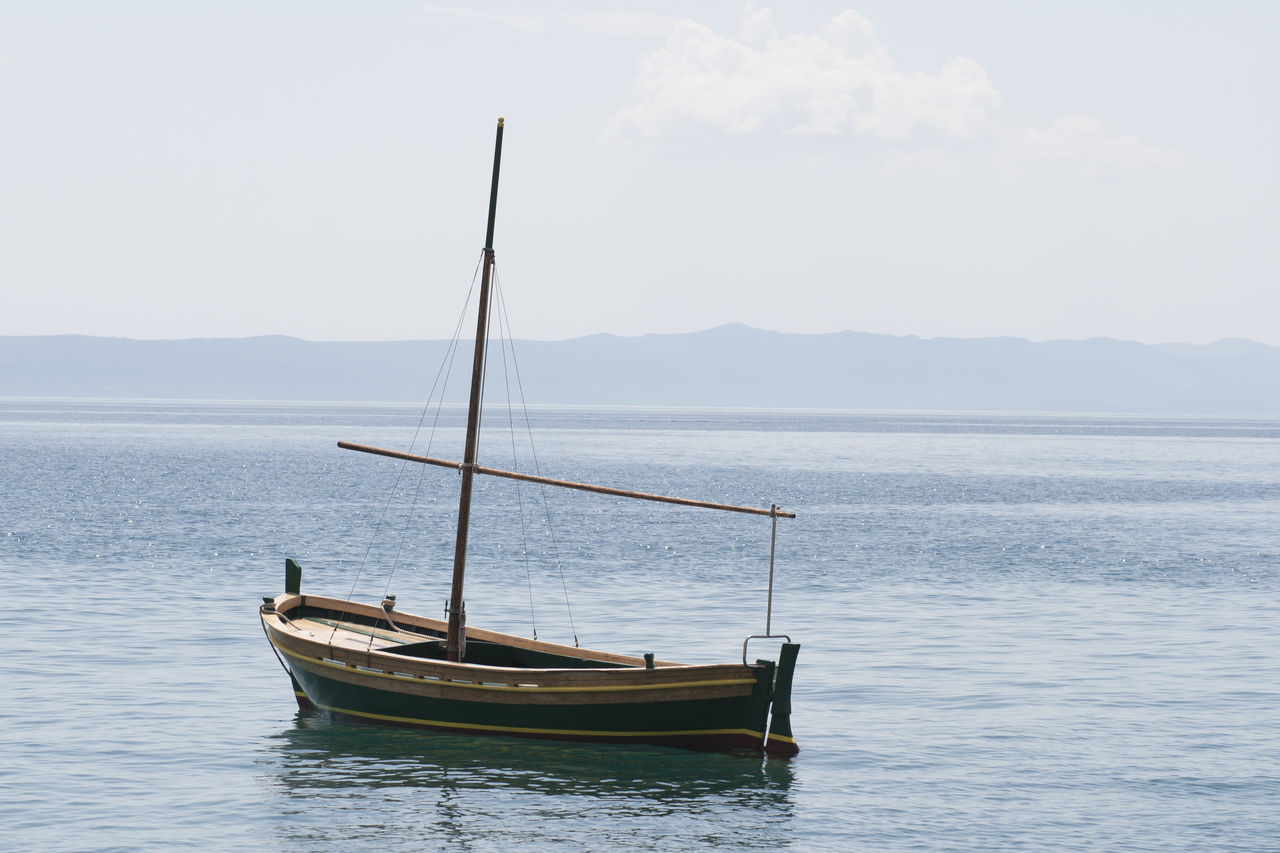 Abandoned Beauty In Nature Boat Boats Day Horizon Horizon Over Water Landscape Loneliness Lonely Mountain Nature Nautical Vessel No People Outdoors Sailboat Sailing Scenics Sea Sky Tranquility Water Wooden Boat Yacht Yachting