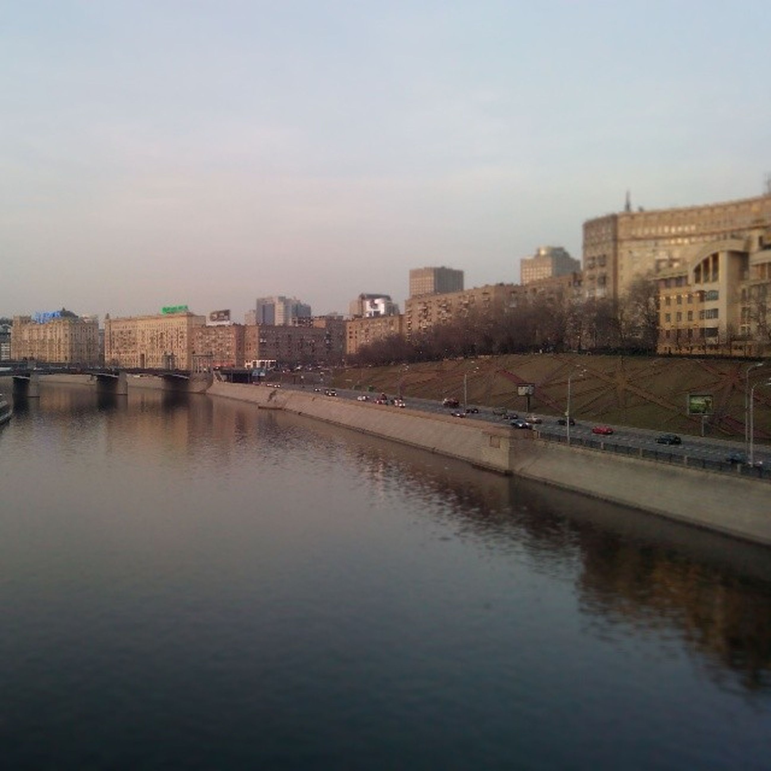 architecture, building exterior, built structure, water, waterfront, city, river, sky, canal, cityscape, building, bridge - man made structure, residential building, connection, residential structure, reflection, transportation, day, city life, outdoors
