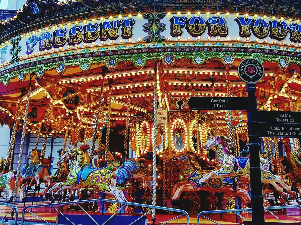 Multi Colored Amusement Park No People Carousel Outdoors Fairground Attraction Childhood Ride Bright Colours Bright_and_bold Brightly Lit British Seaside Britishness Culture Colours And Light Trafford Centre