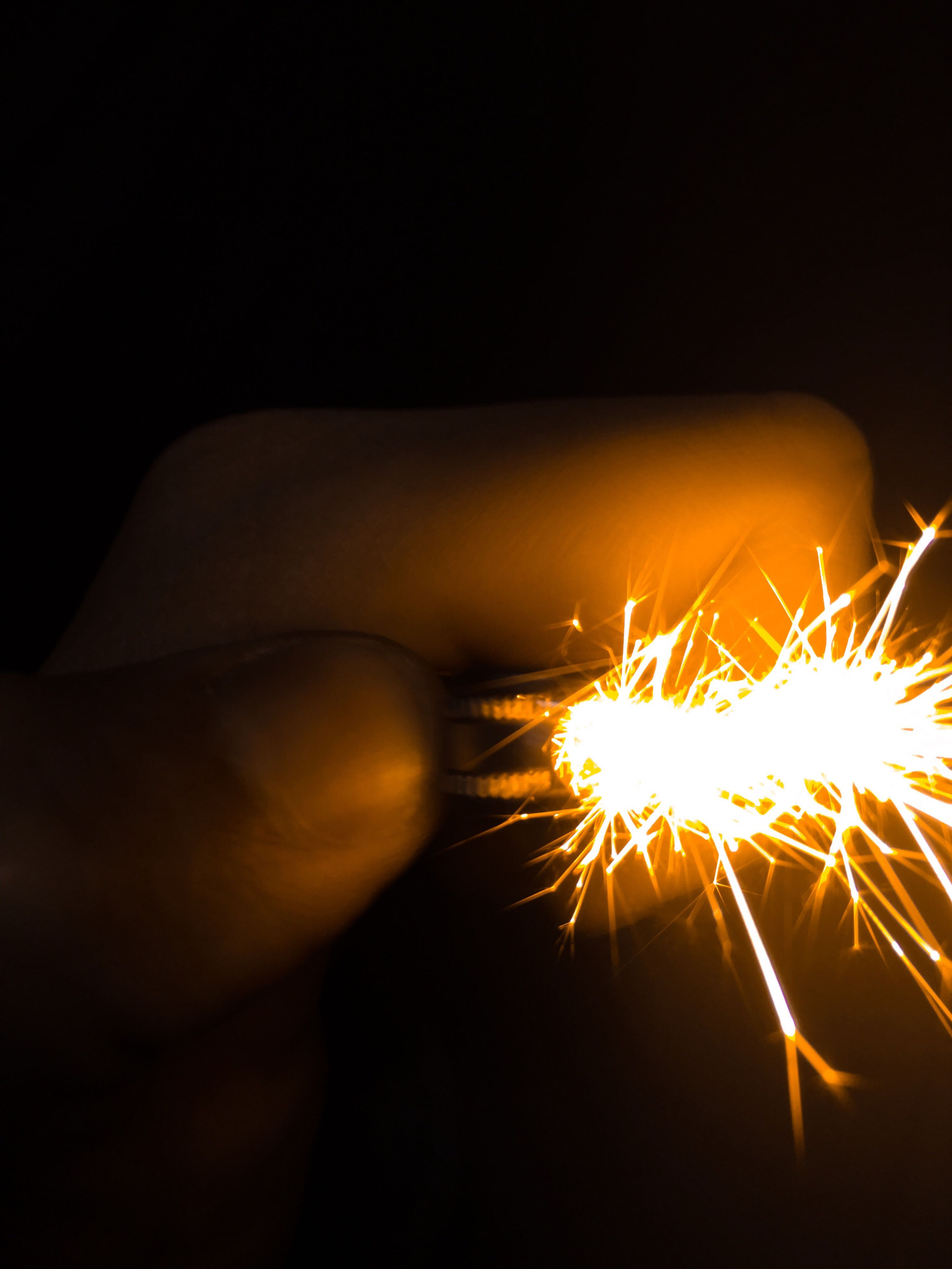 burning, illuminated, fire - natural phenomenon, flame, glowing, night, heat - temperature, lit, black background, studio shot, close-up, dark, copy space, long exposure, motion, fire, sparks, light - natural phenomenon, one person, part of