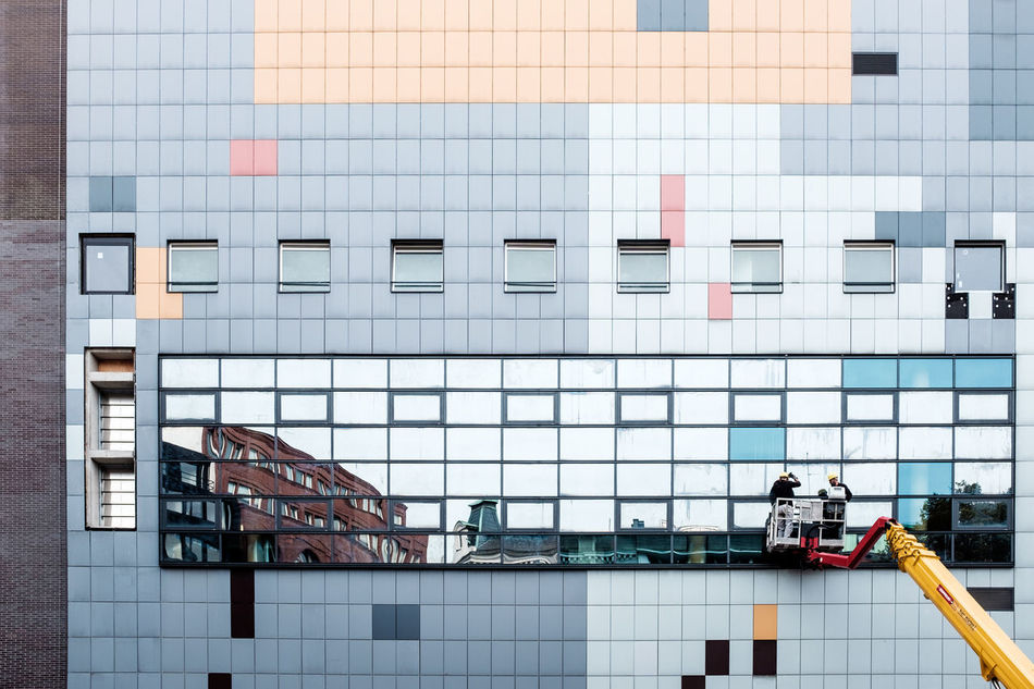 Architectural Feature Architecture Building Exterior Building Story Built Structure City City Life Cleaning Communication Day Development Exterior Geometric Shape Modern No People Office Building Window Workers