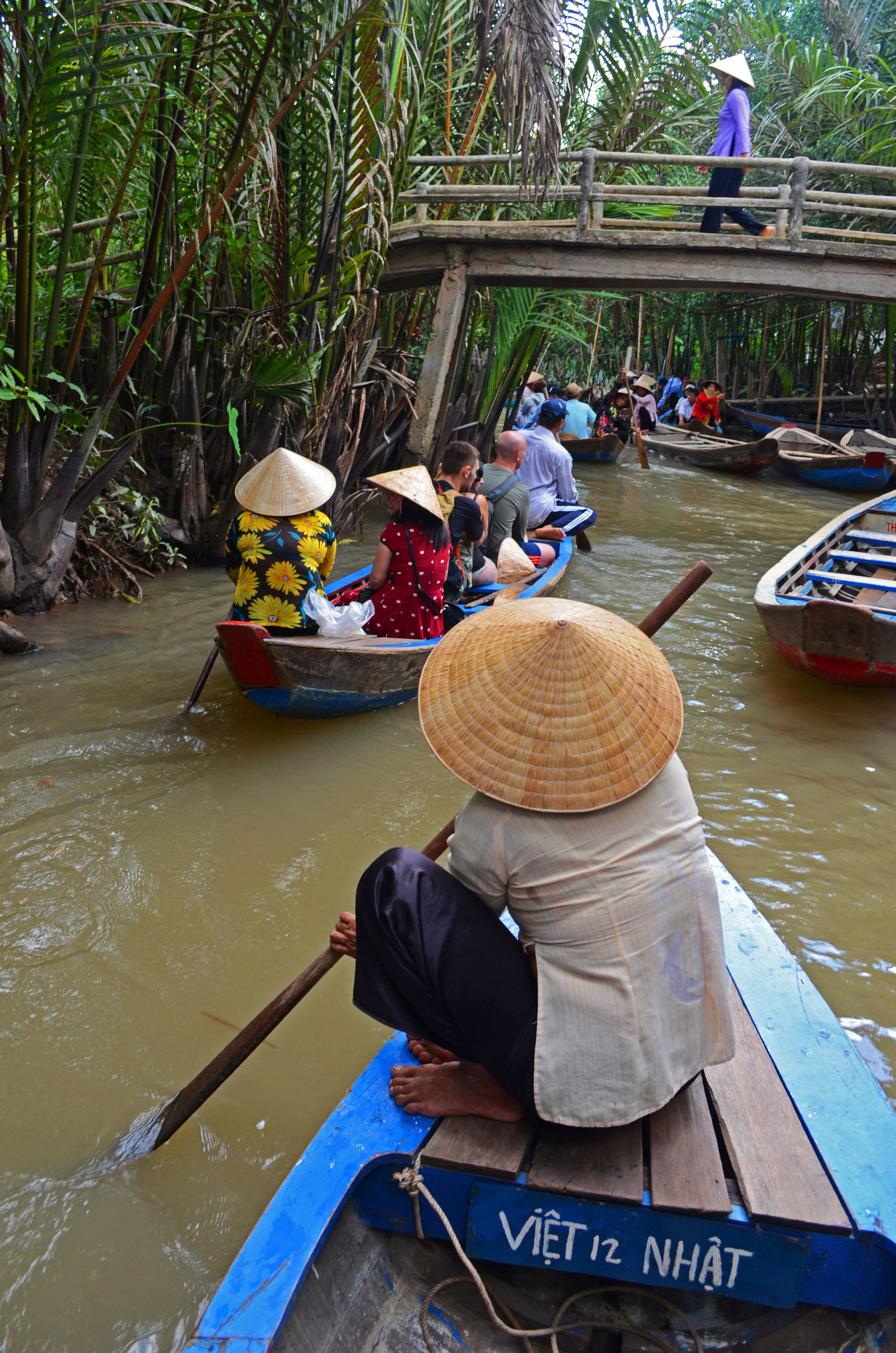 Asian Culture Bridge Canoe Hat Lifestyles Mekong Delta Mekong River Modeoftransport Real People Rowing Tradition Woman Women