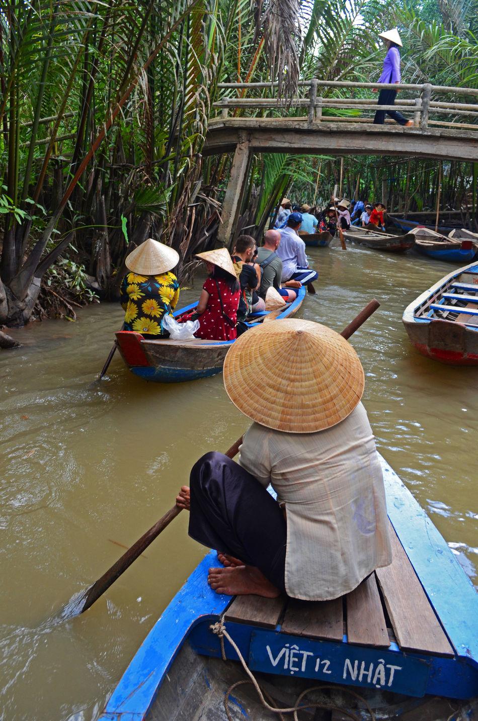 Asian Culture Bridge Canoe Hat Lifestyles Mekong Delta Mekong River Modeoftransport Real People Rowing Tradition Woman Women