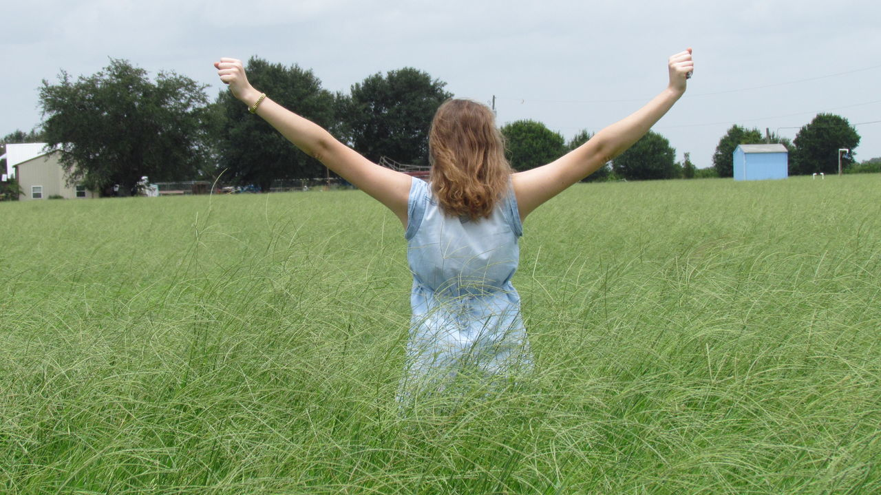Person Field Green Grass Day Freedom Blue Blue Sky Nature Back Alone Away Outdoors Adult Loose Hair