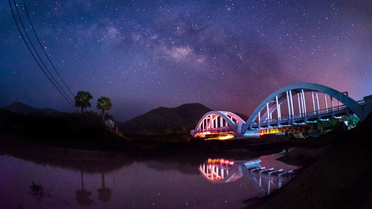 Tha Chomphu Bridge, Tha Pla Duk, Lamphun, Thailand Architecture Arrival Arts Culture And Entertainment Astronomy Bridge - Man Made Structure Landscape Milky Way Night Night Lights Night Photography Nightphotography No People Outdoors Rail Transportation Railway Sky Sky And Clouds Star Star - Space Star Trail Thailand Travel Vacations Water